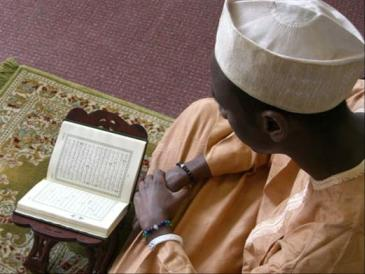 Abdullahi Arabo, wearing Peace Malas and reading the Holy Qur'an in Swansea University Mosque