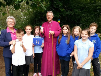 Archbishop John with our Symbolic Dove of Peace for interfaith, the founder, and pupils of Rhayader Primary School after their Peace Mala Accreditation Ceremony