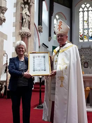 Pam Evans, Founder of Peace Mala, receiving the Apostolic Blessing from Bishop Tom Burns of Menevia