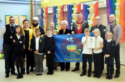 Newall Green Primary School receiving the Peace Mala Re-Accreditation Silver Award