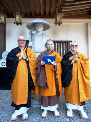 Vice-Abbot Zoju-san holding Peace Dove No. 14 with great honour, along with Yozen and Kakua
