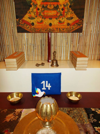 Symbolic Peace Dove No. 14 resting on the shrine at Gloucester Buddhist Centre