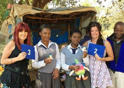 Rachel Webb and Zambian students with Dove 3 and Amy Grundy with Dove 2 and Zambian teacher