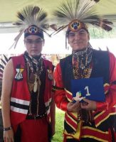 Mark F Sison with Peace Dove 1 and his son Tyler at the 39th Annual Muckleshoot Skopabsh Pow Wow