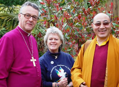 Bishop John with Pam Evans and Choje Lama Rabsang in the peace garden at Peace Mala HQ Morriston