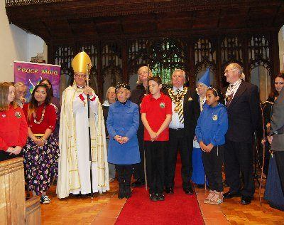 Bishop John with some of the pupils, faith representatives, Keith Broadbent MBE Deputy Lord Lieutenant of West Glamorgan, and Mayor of Neath Port Talbot County Council, Cllr Martyn Peters
