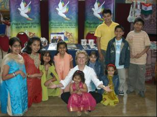 Pam Evans with children from the Indian community at the Mela