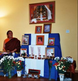 Lama Khymisar Rinpoche with the Yungdrung Bon shrine in the Peace Mala Centre