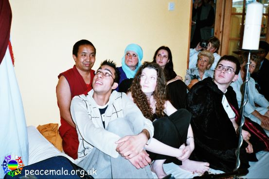Buddhist, Muslim, Pagan, Jewish and Christian guests listening to Lama Khymisar Rinpoche's speech