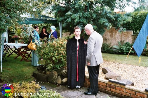 Paul Rousselle, Pagan, talking to John Allman, Tibetan Buddhist with Sufi ladies in the background