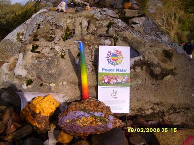 Ruth left rainbow candles and Peace Mala literature at stopping places along the Camino
