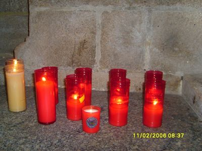 Ruth's lit Peace Mala votive candle inside the Convent of San Francisco