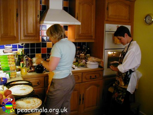 Chris and Helen in the kitchen, preparing lunch for guests