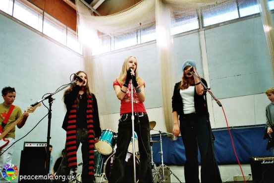 A girl band performing on stage