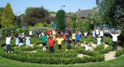 Woodheys pupils in the school's positive energy Labyrinth garden