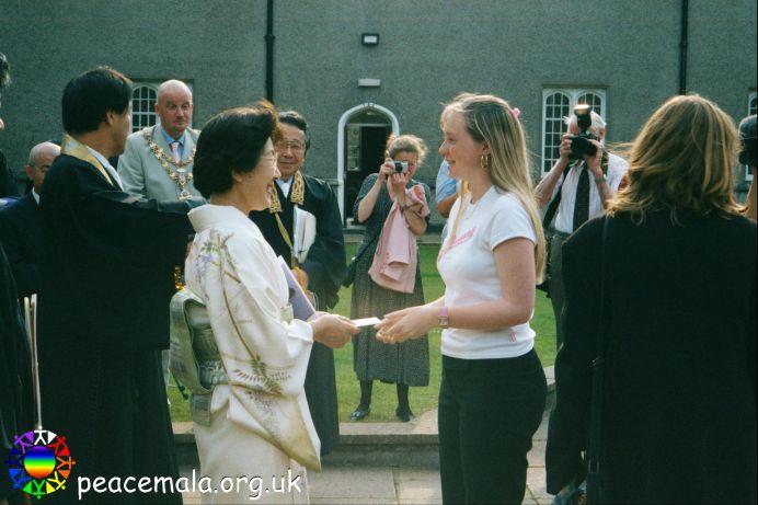 Emily Morris presenting a Peace Mala to The Primate's mother, Lady Kiyoko Otani