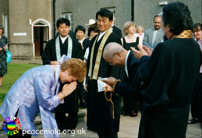 Pam Evans presenting another Peace Mala to the Reverend Professor Kemmyo Taira Sato